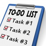 30917600 - to do list clipboard with check boxes marked for task one, two and three